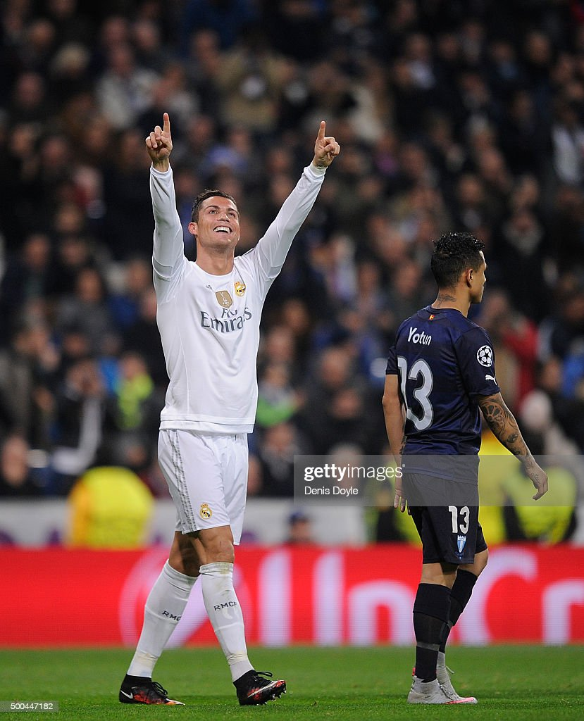 Cristiano Ronaldo of Real Madrid celebrates after scoring Real's 5th goal during the UEFA Champions League Group A match between Real Madrid CF and Malmo FF at the Santiago Bernabeu stadium on December 8, 2015 in Madrid, Spain.