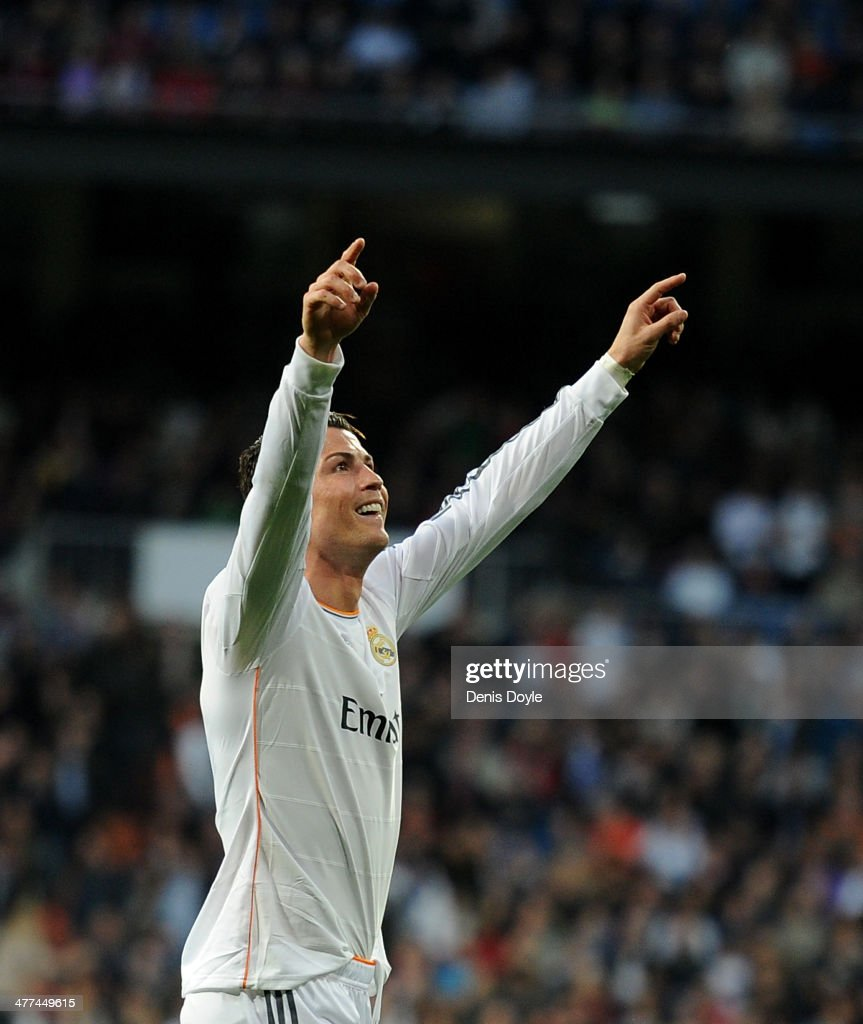 Cristiano Ronaldo of Real Madrid celebrates after scoring Real's opening goal during the La Liga match between Real Madrid CF and Levante UD at Santiago Bernabeu stadium on March 9, 2014 in Madrid, Spain.