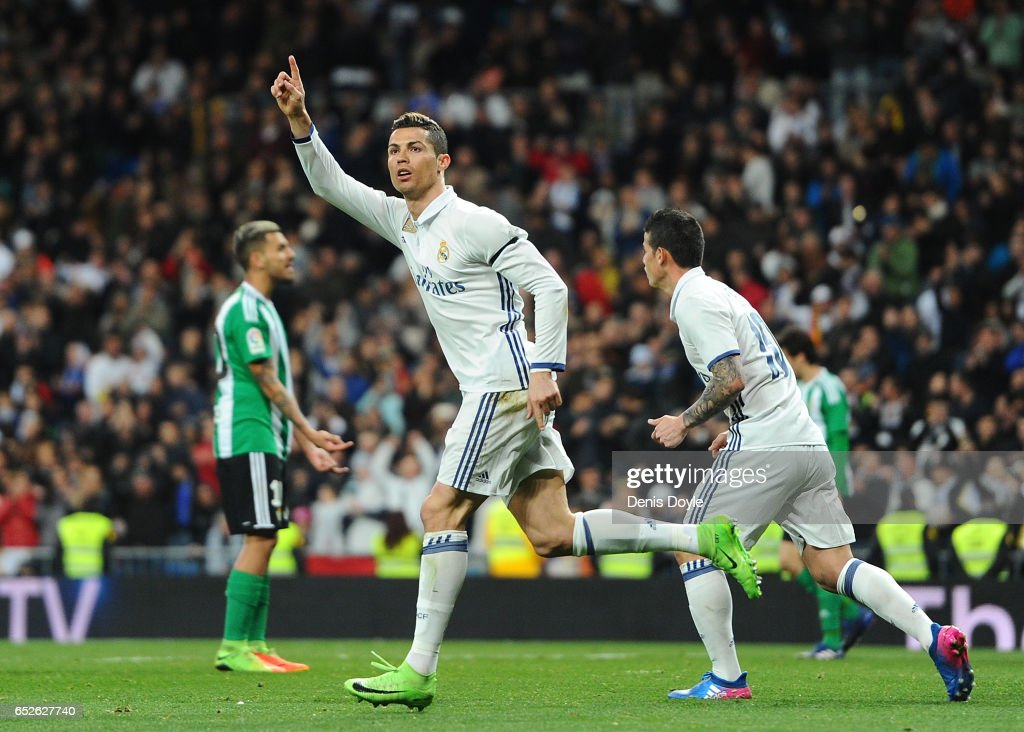 Cristiano Ronaldo of Real Madrid celebrates after scoring Real's opening goal during the La Liga match between Real Madrid CF and Real Betis Balompie at Estadio Santiago Bernabeu on March 12, 2017 in Madrid, Spain.