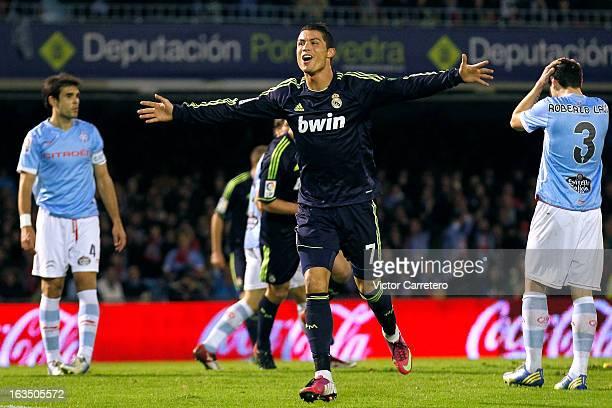 Cristiano Ronaldo of Real Madrid celebrates after scoring the opening goal during the La Liga match between Celta de Vigo and Real Madrid at Estadio...