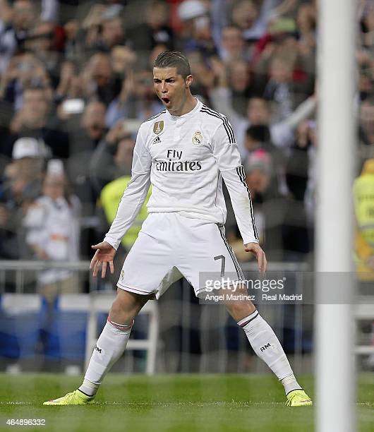 Cristiano Ronaldo of Real Madrid celebrates after scoring the opening goal from penalty spot during the La Liga match between Real Madrid CF and...