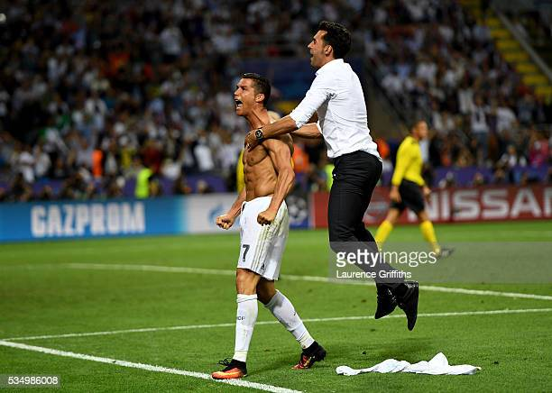 Cristiano Ronaldo of Real Madrid celebrates after scoring the winning penalty during the UEFA Champions League Final match between Real Madrid and...