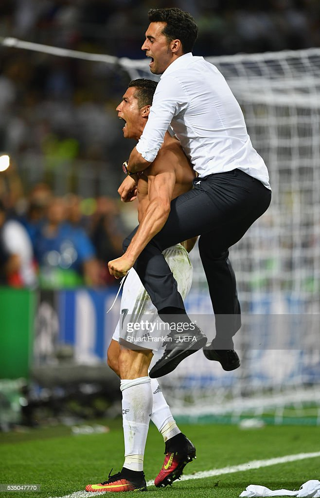 Cristiano Ronaldo of Real Madrid celebrates after scoring the winning penalty in the penalty shootout during the UEFA Champions League Final between Real Madrid and Club Atletico de Madrid at Stadio Giuseppe Meazza on May 28, 2016 in Milan, Italy.