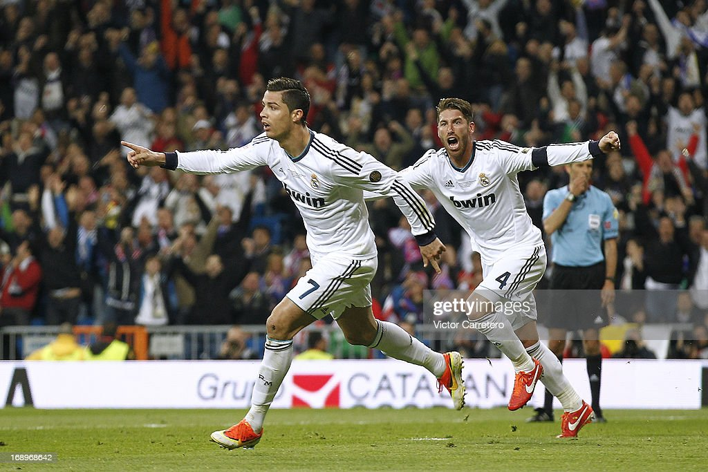 Cristiano Ronaldo (L) of Real Madrid celebrates after scoring their first goal during the Copa del Rey Final match between Real Madrid and Atletico de Madrid at Estadio Santiago Bernabeu on May 17, 2013 in Madrid, Spain.