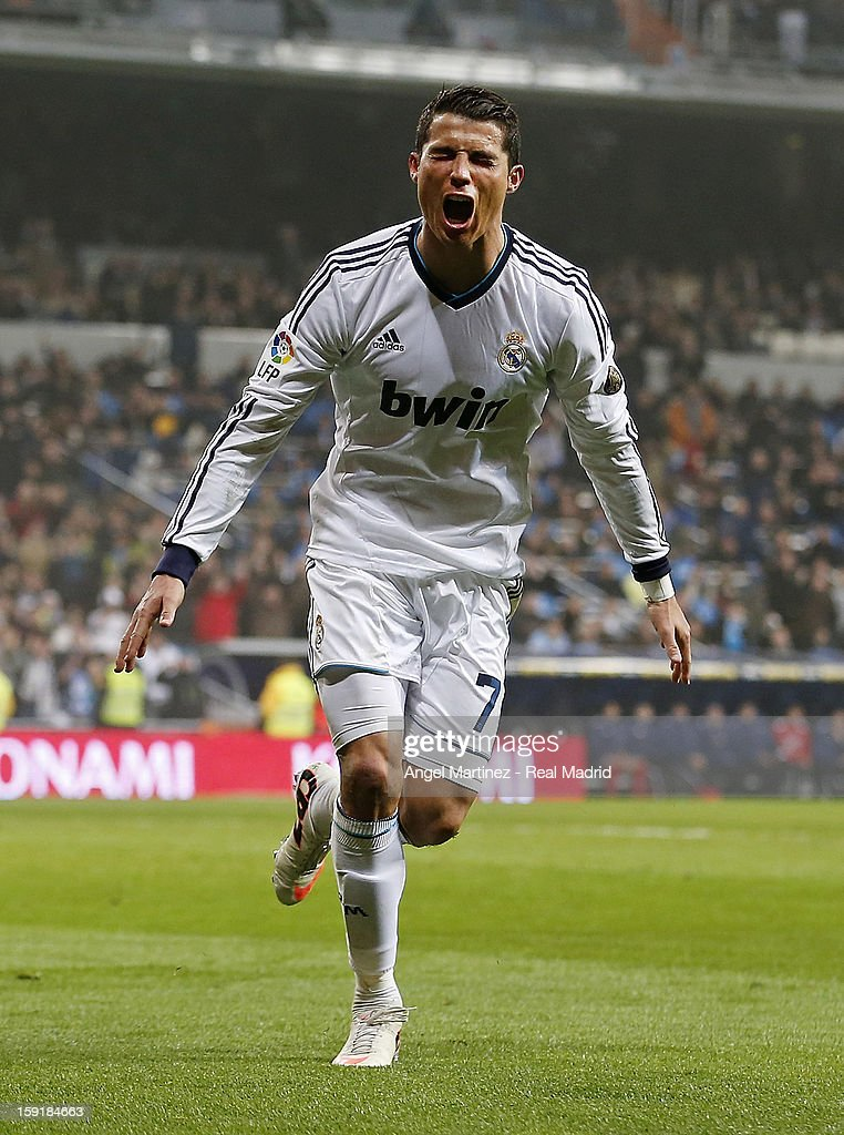 Cristiano Ronaldo of Real Madrid celebrates after scoring their third goal and completing his hat-trick during the Copa del Rey round of 16 second leg match between Real Madrid and Celta de Vigo at Estadio Santiago Bernabeu on January 9, 2013 in Madrid, Spain.