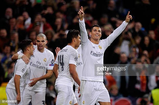 Cristiano Ronaldo of Real Madrid celebrates aftr scoring Real's opening goal during the UEFA Champions League Round of 16 Second Leg match between...