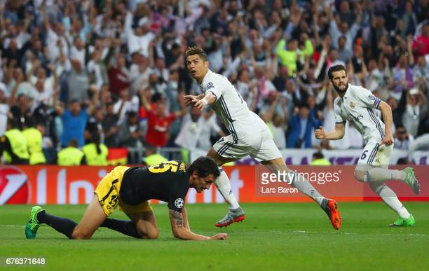 Cristiano Ronaldo of Real Madrid celebrates as he scores their second goal during the UEFA Champions League semi final first leg match between Real...