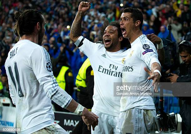 Cristiano Ronaldo of Real Madrid celebrates as he scores their third goal from a free kick and completes his hat trick with Gareth Bale and Marcelo...