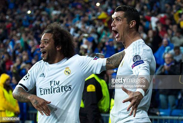 Cristiano Ronaldo of Real Madrid celebrates as he scores their third goal from a free kick and completes his hat trick with Marcelo during the UEFA...