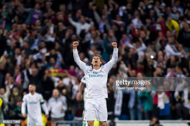Cristiano Ronaldo of Real Madrid celebrates at the full time during the UEFA Champions League Semi Final Second Leg match between Real Madrid and...