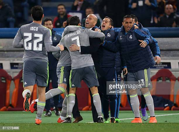 Cristiano Ronaldo of Real Madrid celebrates his goal with coach of Real Madrid Zinedine Zidane during the UEFA Champions League round of 16 first leg...