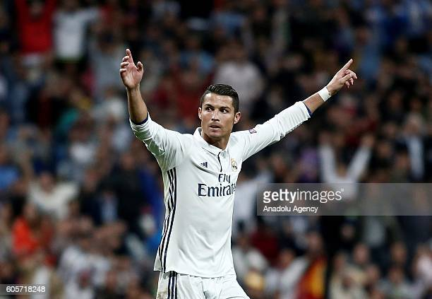 Cristiano Ronaldo of Real Madrid celebrates his score with his team mates during UEFA Champions League Group F match between Real Madrid and Sporting...