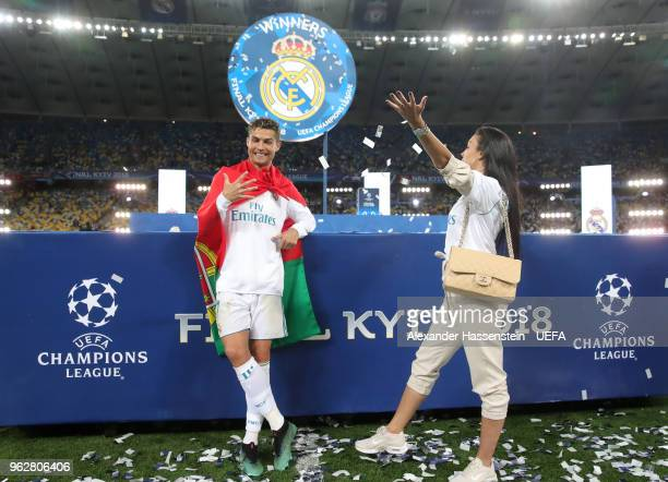Cristiano Ronaldo of Real Madrid celebrates his sides victory with his girlfriend Georgina Rodriguez following winning the UEFA Champions League...