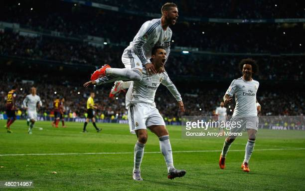 Cristiano Ronaldo of Real Madrid celebrates his team's third goal with Sergio Ramos of Real Madrid during the La Liga match between Real Madrid CF...