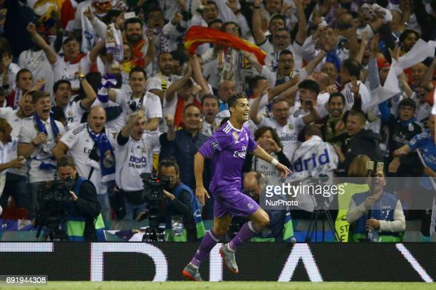 Cristiano Ronaldo of Real Madrid celebrates scoring a goal to make the score 13 during the UEFA Champions League Final between Juventus and Real...