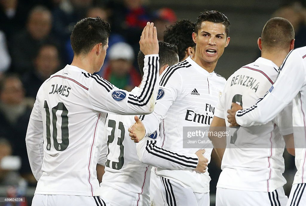 Cristiano Ronaldo of Real Madrid (R) celebrates scoring a goal with team mates during the UEFA Champions League Group B match between FC Basel 1893 and Real Madrid CF at St. Jakob-Park stadium on November 26, 2014 in Basel, Basel-Stadt, Switzerland.