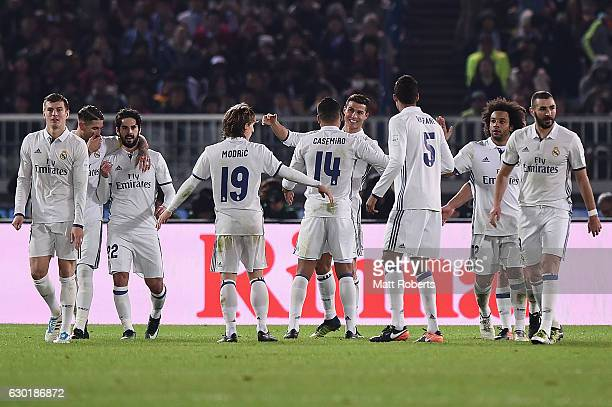 Cristiano Ronaldo of Real Madrid celebrates scoring a goal with team mates during the FIFA Club World Cup final match between Real Madrid and Kashima...