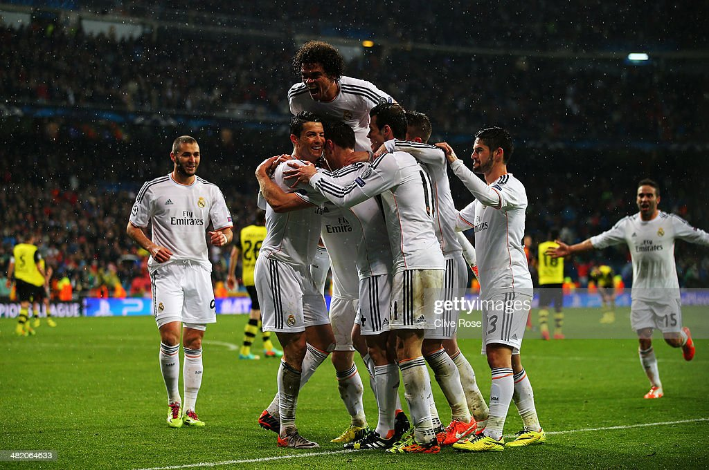 Cristiano Ronaldo of Real Madrid celebrates scoring his goal with team mates during the UEFA Champions League Quarter Final first leg match between Real Madrid and Borussia Dortmund at Estadio Santiago Bernabeu on April 2, 2014 in Madrid, Spain.