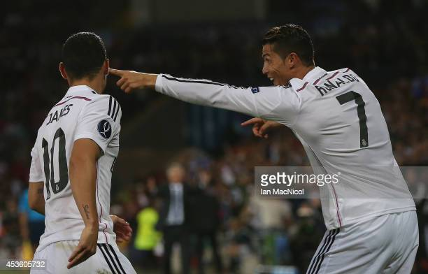 Cristiano Ronaldo of Real Madrid celebrates scoring his second goal during the UEFA Super Cup match between Real Madrid and Sevilla at Cardiff City...