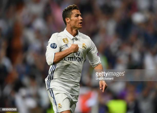Cristiano Ronaldo of Real Madrid celebrates scoring his sides first goal and his hatrick during the UEFA Champions League Quarter Final second leg...