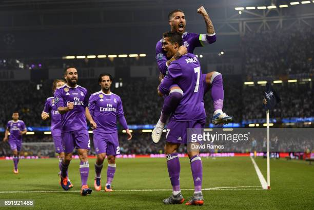 Cristiano Ronaldo of Real Madrid celebrates scoring his sides first goal with Sergio Ramos of Real Madrid during the UEFA Champions League Final...