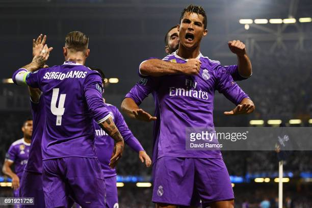 Cristiano Ronaldo of Real Madrid celebrates scoring his sides first goal with his Real Madrid team mates during the UEFA Champions League Final...