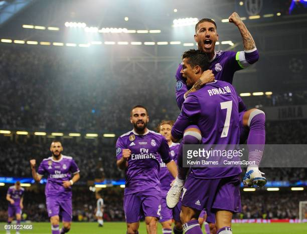 Cristiano Ronaldo of Real Madrid celebrates scoring his sides first goal with teammate Sergio Ramos during the UEFA Champions League Final match...