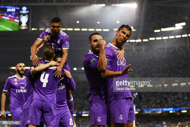 Cristiano Ronaldo of Real Madrid celebrates scoring his sides first goal with Daniel Carvajal of Real Madrid during the UEFA Champions League Final...