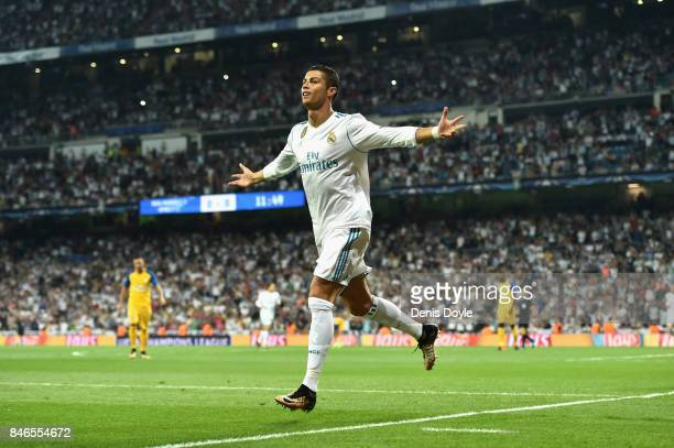 Cristiano Ronaldo of Real Madrid celebrates scoring his sides first goal during the UEFA Champions League group H match between Real Madrid and APOEL...