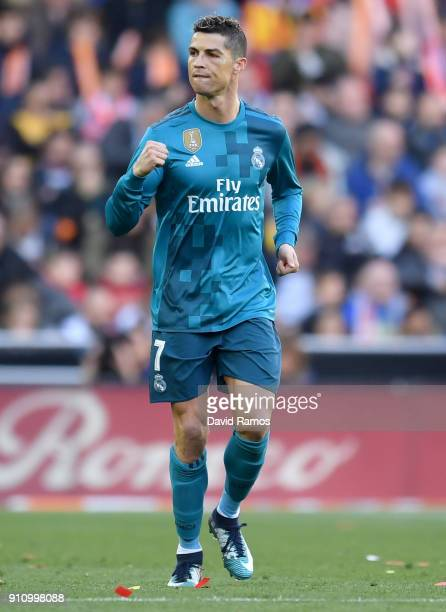 Cristiano Ronaldo of Real Madrid celebrates scoring his side's first goal during the La Liga match between Valencia and Real Madrid at Estadio...