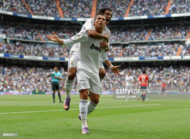 Cristiano Ronaldo of Real Madrid celebrates scoring his sides equalizing goal with his teammate Marcelo Vieira during the La Liga match between Real...