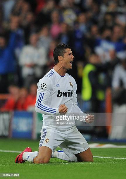Cristiano Ronaldo of Real Madrid celebrates scoring his sides opening goal from a free kick during the UEFA Champions League group G match between...