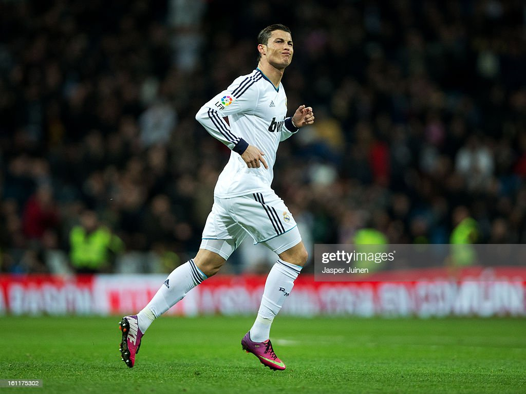 Real madrid cf v sevilla fc la liga photos and images getty images cristiano ronaldo of real madrid celebrates scoring his sides second goal during the la liga match voltagebd Gallery