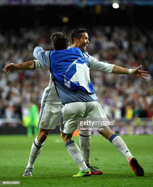 Cristiano Ronaldo of Real Madrid celebrates scoring his sides second goal with his team mate during the UEFA Champions League Quarter Final second...