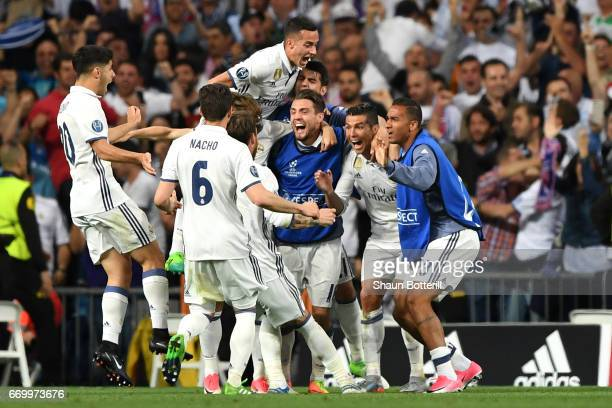 Cristiano Ronaldo of Real Madrid celebrates scoring his sides second goal with his Real Madrid team mates during the UEFA Champions League Quarter...