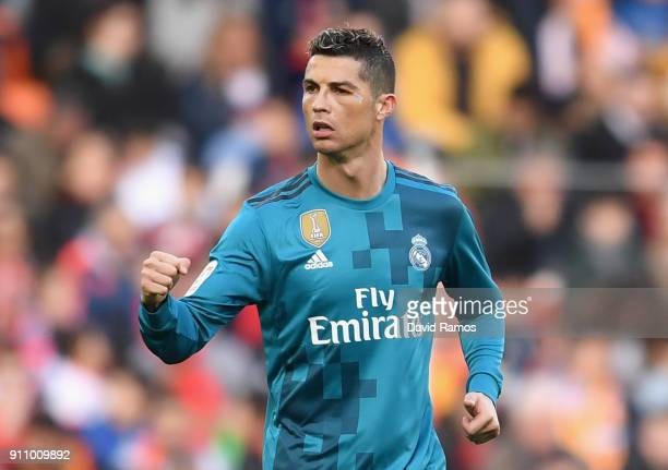 Cristiano Ronaldo of Real Madrid celebrates scoring his side's second goal from the penalty spot during the La Liga match between Valencia and Real...