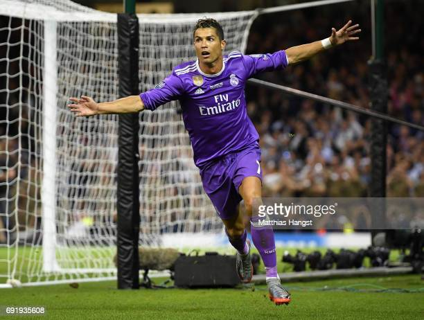 Cristiano Ronaldo of Real Madrid celebrates scoring his sides third goal during the UEFA Champions League Final between Juventus and Real Madrid at...