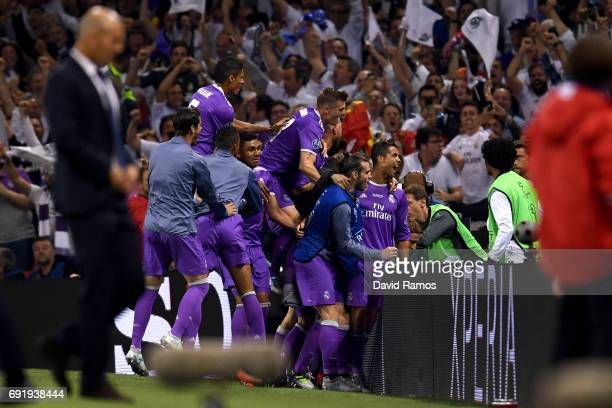 Cristiano Ronaldo of Real Madrid celebrates scoring his sides third goal with his Real Madrid team mates during the UEFA Champions League Final...