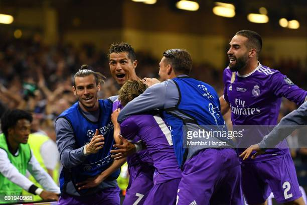 Cristiano Ronaldo of Real Madrid celebrates scoring his sides third goal with teammates during the UEFA Champions League Final between Juventus and...