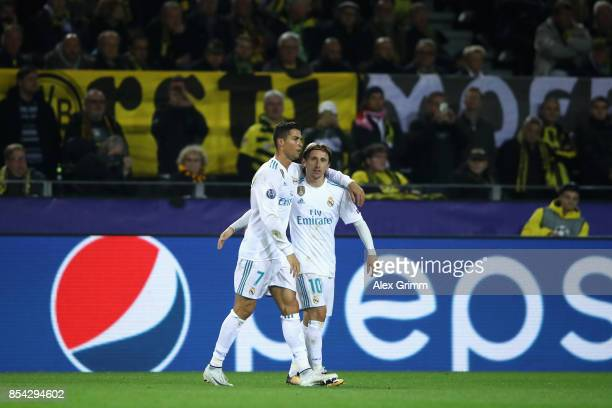 Cristiano Ronaldo of Real Madrid celebrates scoring his sides third goal with Luka Modric of Real Madrid during the UEFA Champions League group H...