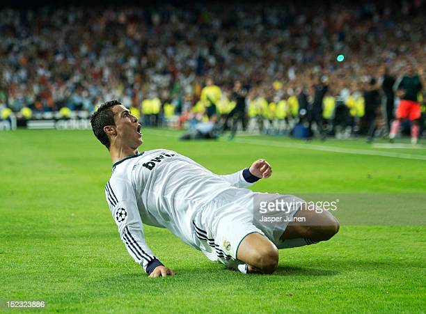 Cristiano Ronaldo of Real Madrid celebrates scoring his sides winning goal during the UEFA Champions League group D match between Real Madrid and...