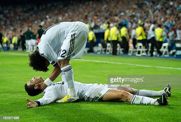 Cristiano Ronaldo of Real Madrid celebrates scoring his sides winning goal with his teammate Marcelo during the UEFA Champions League group D match...