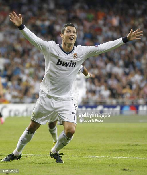 Cristiano Ronaldo of Real Madrid celebrates scoring his team third goal during the UEFA Champions League Group D match between Real Madrid and...