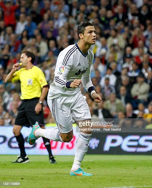 Cristiano Ronaldo of Real Madrid celebrates scoring the opening goal during the La Liga match between Real Madrid and Deportivo La Coruna at Santiago...