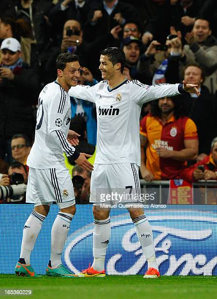 Cristiano Ronaldo of Real Madrid celebrates scoring the opening goal with Mesut Oezil during the UEFA Champions League Quarter Final first leg match...