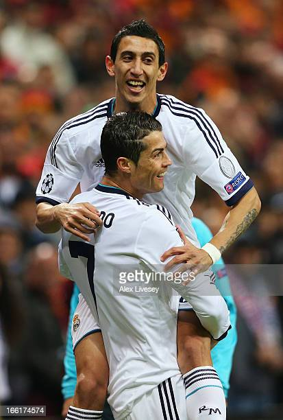 Cristiano Ronaldo of Real Madrid celebrates scoring the opening goal with Angel Di Maria during the UEFA Champions League quarterfinal second leg...