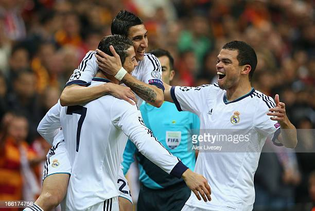 Cristiano Ronaldo of Real Madrid celebrates scoring the opening goal with Pepe and Angel Di Maria during the UEFA Champions League Quarter Final...