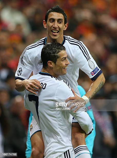 Cristiano Ronaldo of Real Madrid celebrates scoring the opening goal with Angel Di Maria during the UEFA Champions League Quarter Final match between...