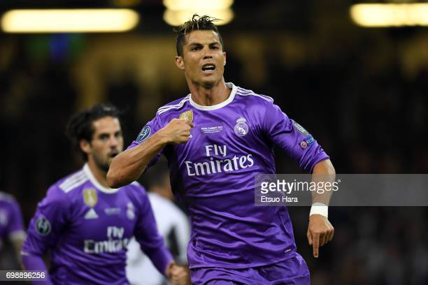 Cristiano Ronaldo of Real Madrid celebrates scoring the opening goal during the UEFA Champions League final match between Juventus and Real Madrid at...
