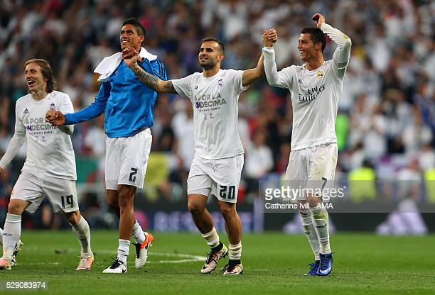 Cristiano Ronaldo of Real Madrid celebrates the win with Jese Raphael Varane and Luka Modric of Real Madrid during the UEFA Champions League Semi...